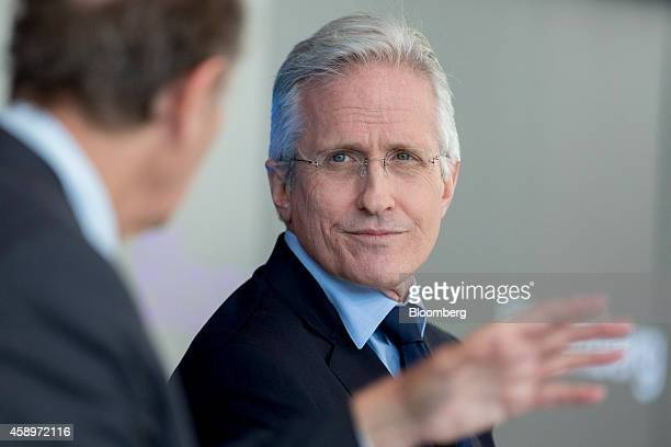 Jim Coulter chairman of TPG Capital listens as David Bonderman founding partner of TPG Capital speaks during a panel discussion at the Bloomberg Year...