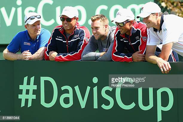 Jim Courier captain of the United States celebrates with his team after a win over Australia during the Davis Cup tie between Australia and the...