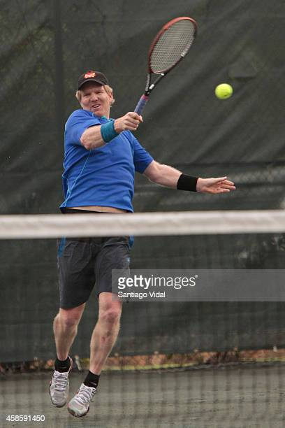Jim Courier hits the ball during an exhibition match between John McEnroe and Jim Courier at Casa de Campo Hotel on November 07 2014 in La Romana...