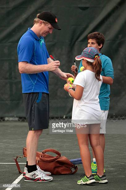 Jim Courier signs autographs after an exhibition match between John McEnroe and Jim Courier at Casa de Campo Hotel on November 07 2014 in La Romana...