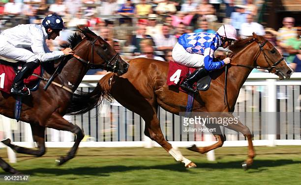 Jim Crowley and Danny's Choice lead the Pat Dobbs ridden Art Scholar home to land The Bet After The Off At Ladbrokescom Novice Stakes Race run at...