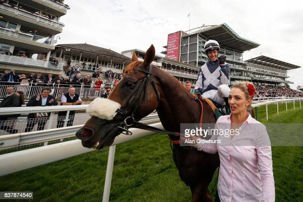 Jim Crowley celebrates after riding Ulysses to win The Juddmonte International Stakes at York racecourse on August 23 2017 in York England