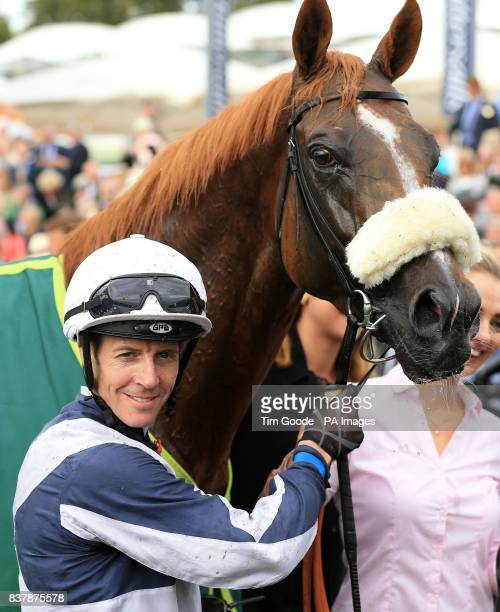 Jim Crowley celebrates after winning the Juddmonte International Stakes on Ulysses during Juddmonte International Day of the Yorkshire Ebor Festival...