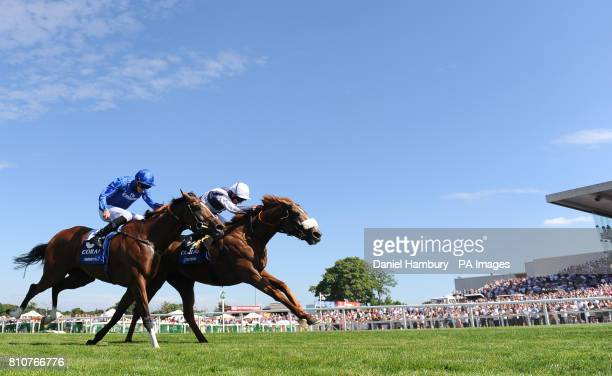 Jim Crowley on board Ulysses wins ahead of James Doyle on board Barney Roy The CoralEclipse race during the Summer Festival at Sandown Park Racecourse