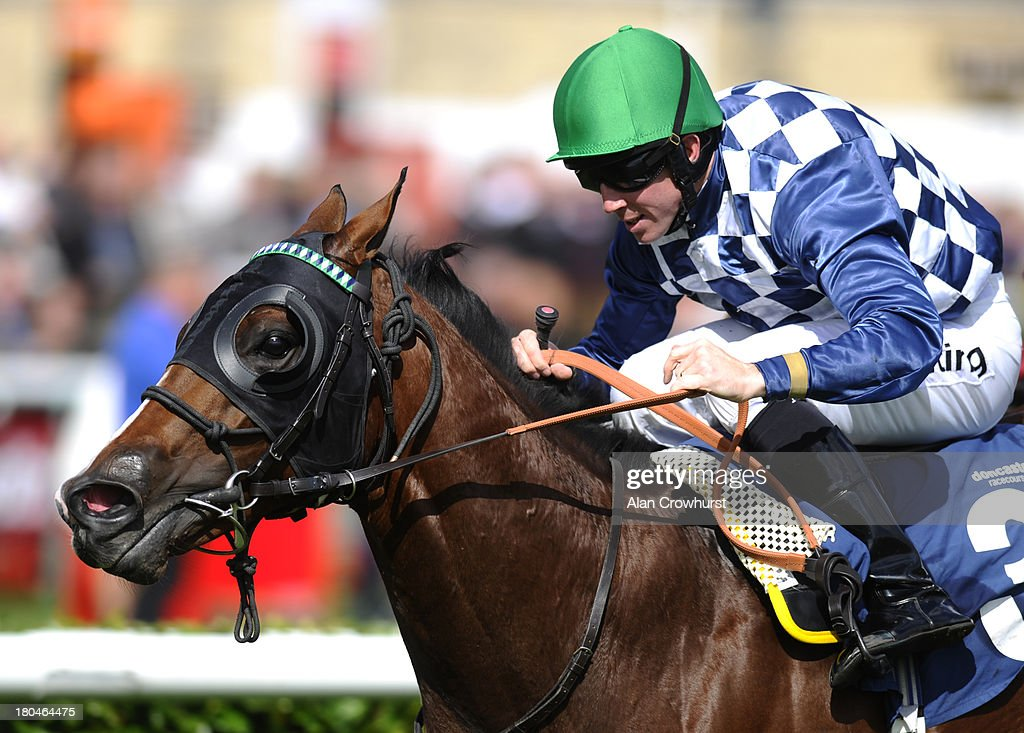 Jim Crowley riding Green Door win The Polypipe Flying Childers Stakes at Doncaster racecourse on September 13, 2013 in Doncaster, England.