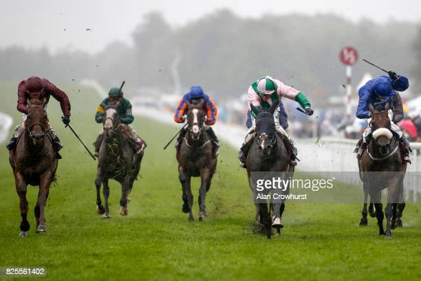 Jim Crowley riding Here Comes When win The Qatar Sussex Stakes from Ribchester on day two of the Qatar Goodwood Festival at Goodwood racecourse on...