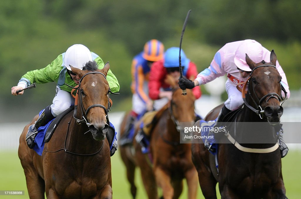 Jim Crowley riding Lunette (L) win The Smith & Williamson Maiden Fillies' Stakes at Salisbury racecourse on June 26, 2013 in Salisbury, England.
