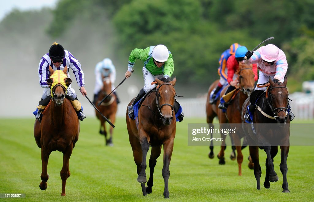 Jim Crowley riding Lunette (C) wins The Smith & Williamson Maiden Fillies' Stakes at Salisbury racecourse on June 26, 2013 in Salisbury, England.