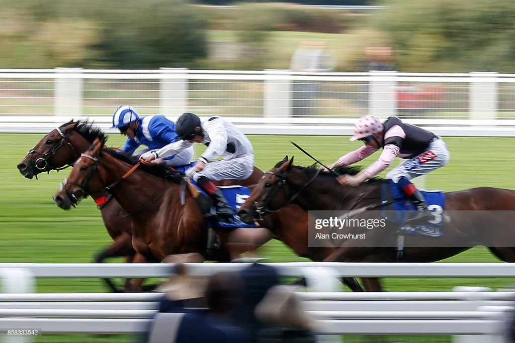 Jim Crowley riding Mukalal (L, blue) win The Troy Asset Management Handicap Stakes at Ascot racecourse on October 6, 2017 in Ascot, United Kingdom.