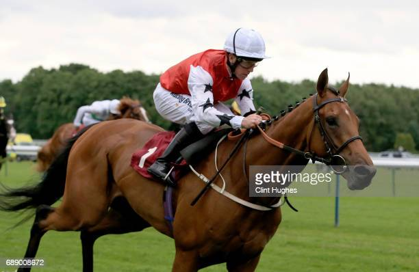 Jim Crowley riding Sofia's Rock wins the Amix Handicap Stakes at Haydock Racecourse on May 27 2017 in Haydock England
