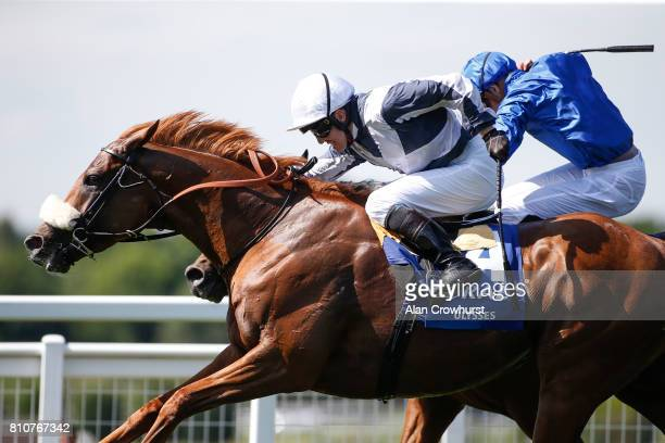 Jim Crowley riding Ulysses win The CoralEclipse from Barney Roy and James Doyle at Sandown Park racecourse on July 8 2017 in Esher England