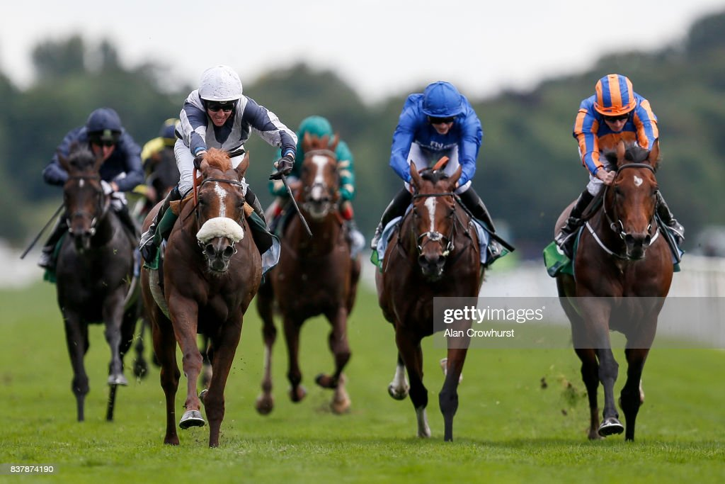Jim Crowley riding Ulysses (L, white cap) win The Juddmonte International Stakes from Churchill (R) at York racecourse on August 23, 2017 in York, England.