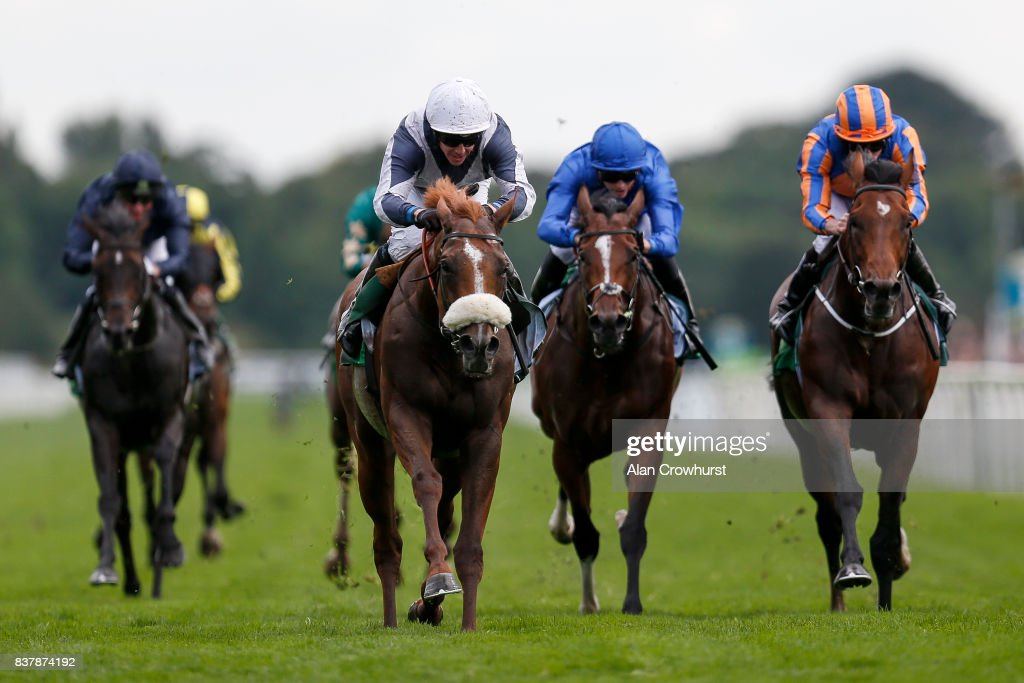 Jim Crowley riding Ulysses (C, white cap) win The Juddmonte International Stakes from Churchill (R) at York racecourse on August 23, 2017 in York, England.