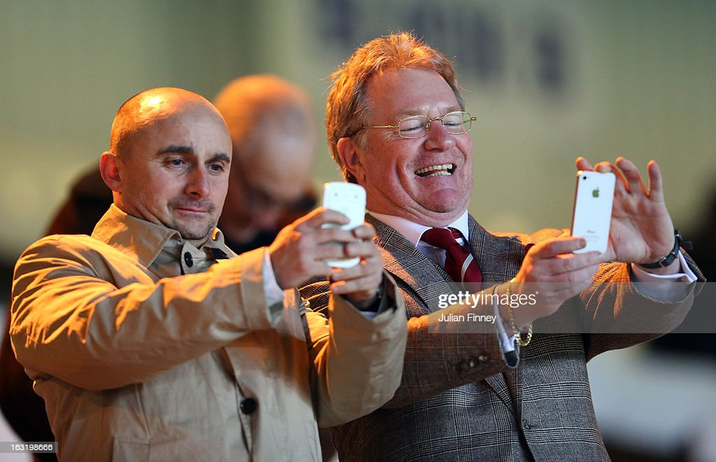 Jim Davidson (R) and friend take photos with their smartphones before the npower Championship match between Peterborough United and Charlton Athletic at London Road Stadium on March 5, 2013 in Peterborough, England.