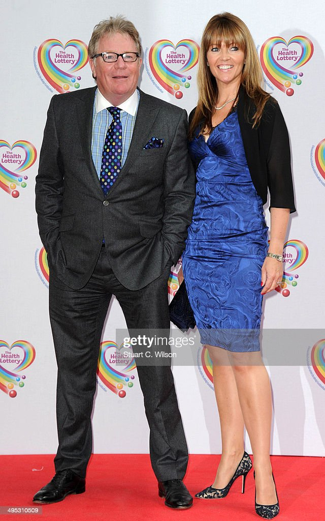 <a gi-track='captionPersonalityLinkClicked' href=/galleries/search?phrase=Jim+Davidson+-+Comedian&family=editorial&specificpeople=1714092 ng-click='$event.stopPropagation()'>Jim Davidson</a> (L) and Michelle Cotton attend the Health Lottery tea party at The Savoy Hotel on June 2, 2014 in London, England.