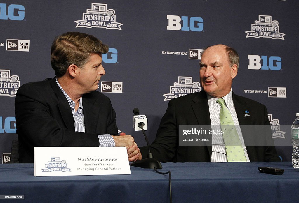 Jim Delany, Commissioner of the Big Ten Conference (R) shakes hands with Hal Steinbrenner, Managing General Partner of the New York Yankees during a press conference to announce the New Era Pinstripe Bowl's eight-year partnership with the Big Ten Conference at Yankees Stadium on June 3, 2013 in the Bronx borough of New York City. (Photo by Jason Szenes/Getty Images