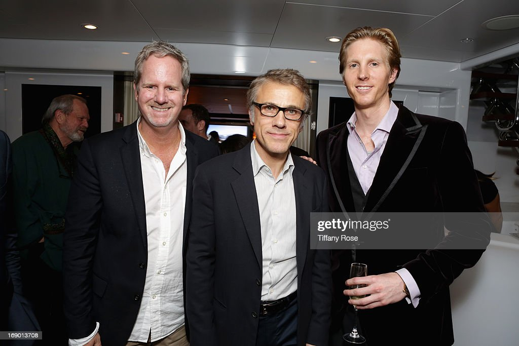 Jim Dobson, <a gi-track='captionPersonalityLinkClicked' href=/galleries/search?phrase=Christoph+Waltz&family=editorial&specificpeople=4276914 ng-click='$event.stopPropagation()'>Christoph Waltz</a> and Kevin Noisetoth attend the Zero Theorem Party Hosted by Terry Gilliam The 66th Annual Cannes Film Festival at Torch at Vegaluna Beach Club on May 18, 2013 in Cannes, France.