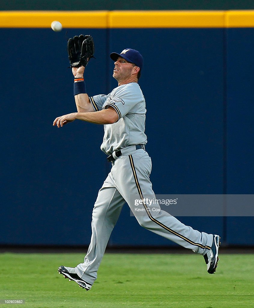 <a gi-track='captionPersonalityLinkClicked' href=/galleries/search?phrase=Jim+Edmonds&family=editorial&specificpeople=171516 ng-click='$event.stopPropagation()'>Jim Edmonds</a> #15 of the Milwaukee Brewers catches a fly ball in the fourth inning by the Atlanta Braves at Turner Field on July 15, 2010 in Atlanta, Georgia.