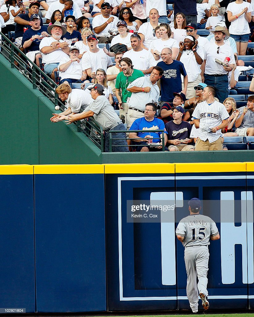 <a gi-track='captionPersonalityLinkClicked' href=/galleries/search?phrase=Jim+Edmonds&family=editorial&specificpeople=171516 ng-click='$event.stopPropagation()'>Jim Edmonds</a> #15 of the Milwaukee Brewers watches as two fans drop the solo homer hit by Chipper Jones #10 (not pictured) of the Atlanta Braves in the third inning at Turner Field on July 15, 2010 in Atlanta, Georgia.