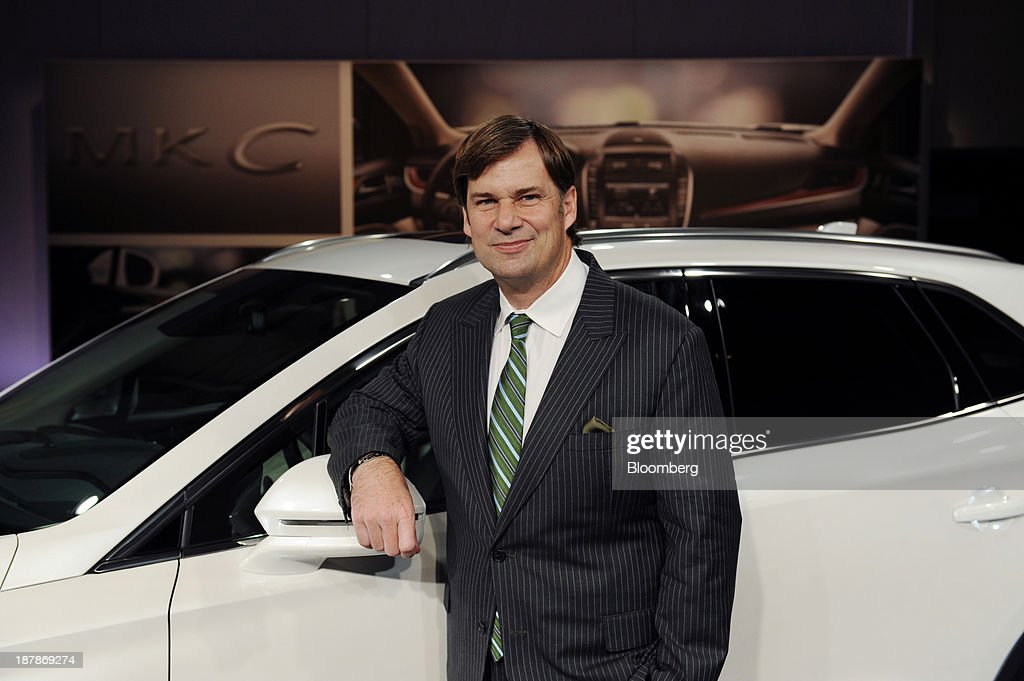 Jim Farley, executive vice president of global marketing and sales at Ford Motor Co., stands for a photograph with the 2015 Lincoln MKC sport-utility vehicle (SUV) in New York, U.S., on Wednesday, Nov. 13, 2013. Ford Motor Co., trying to revive its Lincoln line, said its newest utility vehicle will share little in common with the similarly sized Ford Escape in a bid to lure BMW and Audi buyers. Photographer: Peter Foley/Bloomberg via Getty Images