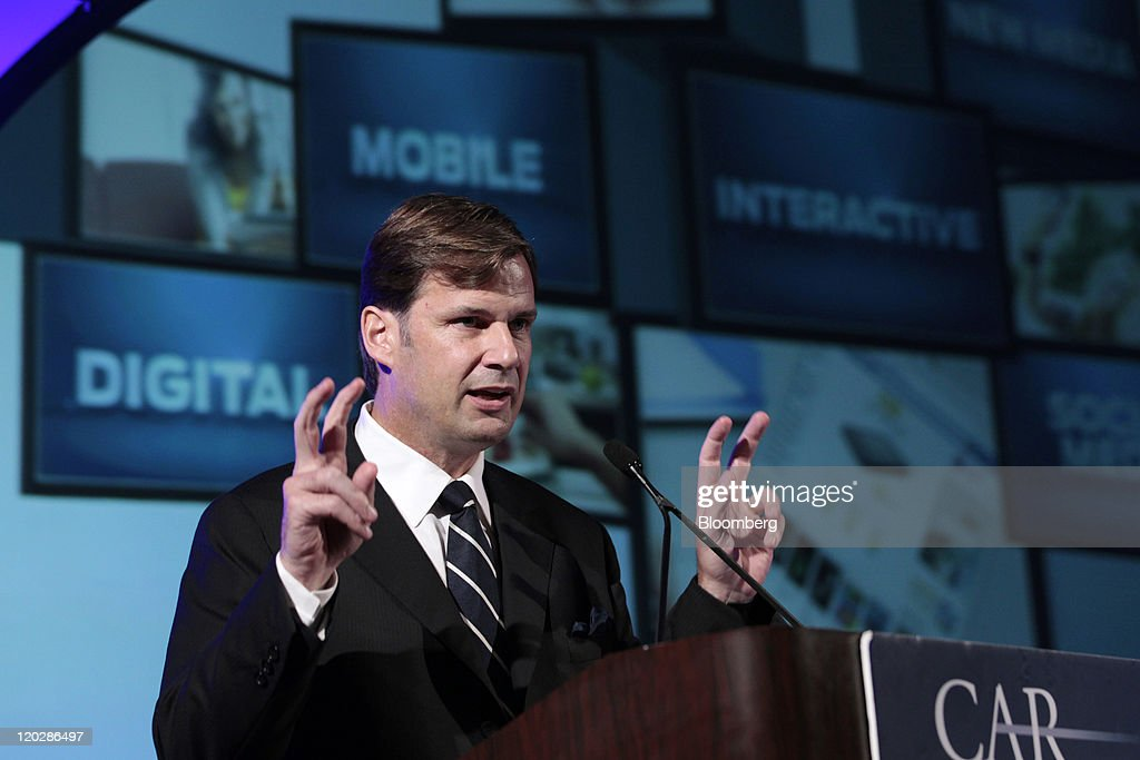 Jim farley head of global marketing for ford motor co gestures as