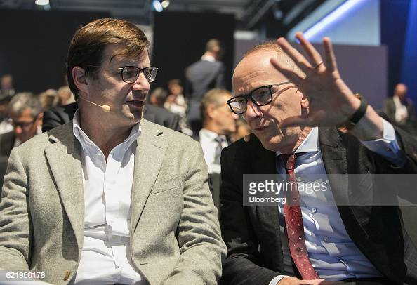 Jim Farley president of Ford Motor Co EMEA left speaks with KarlThomas Neumann chief executive officer of Adam Opel AG during the Handelsblatt...
