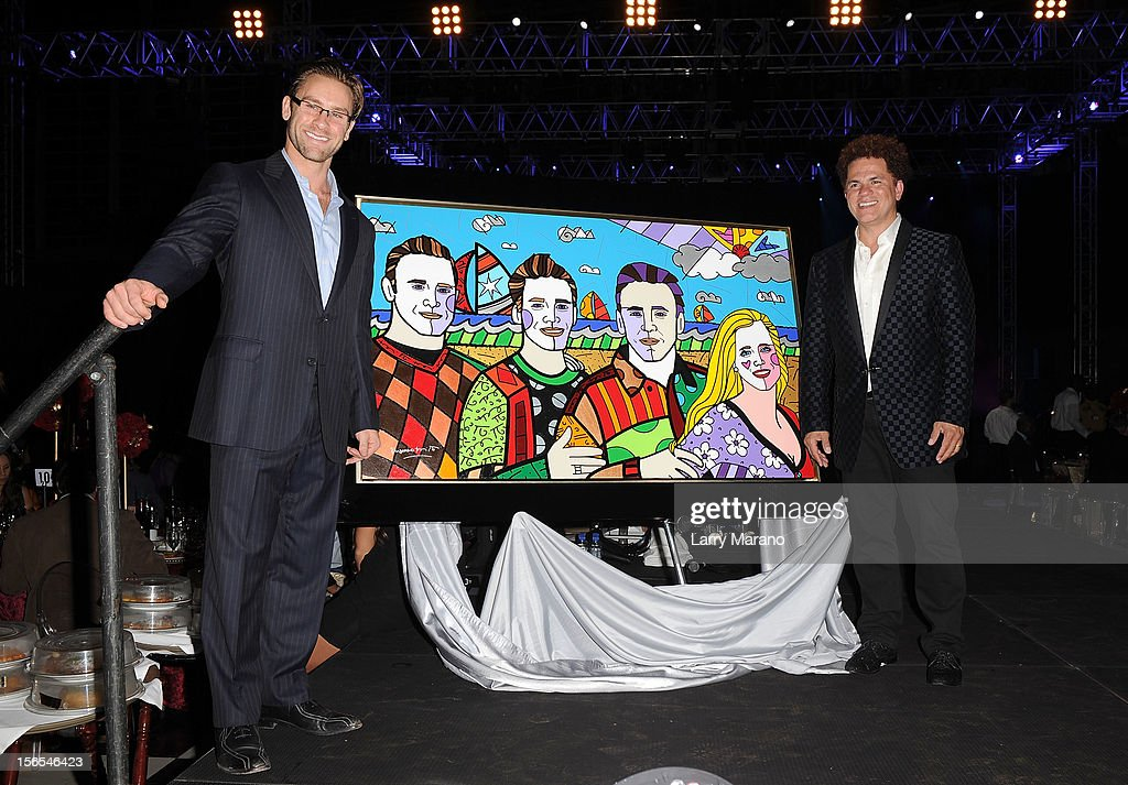 Jim Ferraro Jr. and artist <a gi-track='captionPersonalityLinkClicked' href=/galleries/search?phrase=Romero+Britto&family=editorial&specificpeople=636637 ng-click='$event.stopPropagation()'>Romero Britto</a> pose onstage at the Zenith Watches Best Buddies Miami Gala at Marlins Park on November 16, 2012 in Miami, Florida.