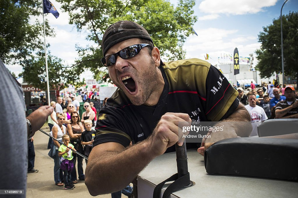 Jim Findley, from Manitoba, Canada, participates in an arm wrestling tournament at the North Dakota state fair on July 27, 2013 in Williston, North Dakota. The western region of North Dakota has seen a rise in crime, automobile accidents and drug usage recently, due in part to the oil boom which has brought tens of thousands of jobs to the region, lowering state unemployment and bringing a surplus to the state budget.