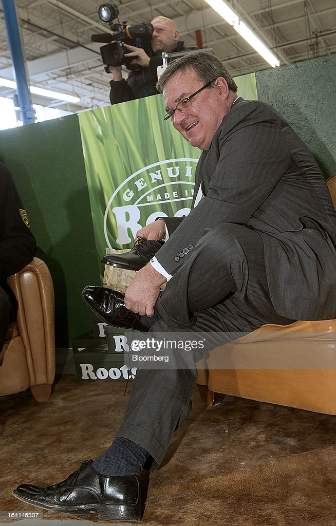 <a gi-track='captionPersonalityLinkClicked' href=/galleries/search?phrase=Jim+Flaherty+-+Politician&family=editorial&specificpeople=12721315 ng-click='$event.stopPropagation()'>Jim Flaherty</a>, Canada's finance minister, center, tries on shoes to purchase, a pre-budget tradition, at the Roots Ltd. manufacturing facility in Toronto, Ontario, Canada, on Wednesday, March 20, 2013. Flaherty said his budget tomorrow will seek to balance the need for sound government finances with growth-promoting steps, including measures to help the nation's manufacturers. Photographer: Norm Betts/Bloomberg via Getty Images