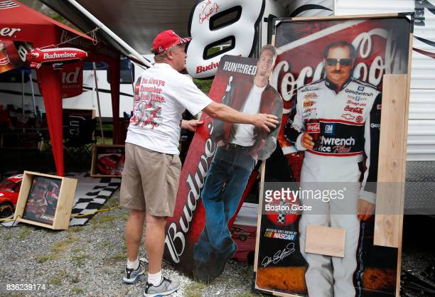 Jim Fox of Tennessee carries one of many life sized cutouts that he owns of Dale Earnhardt Jr to set it up again outside of his campground after a...