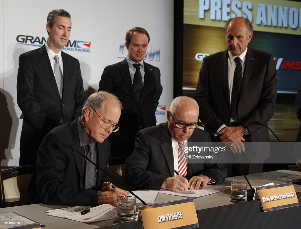 Jim France, Executive Vice President/Secretary, NASCAR and Hans Werner Aufrecht, ITR Board Member sign an agreement at a news conference to announce the GRAND AM IMSA DTM technical license cooperation agreement at the Intercontinental Hotel on March 26, 2013 in New York City.