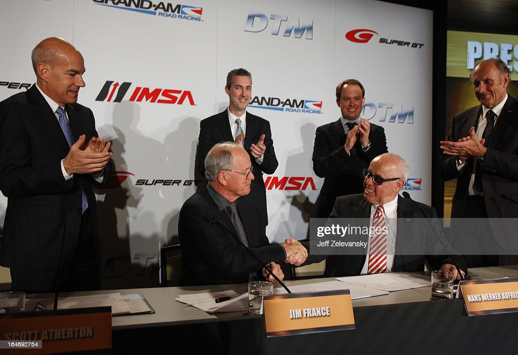 Jim France, Executive Vice President/Secretary, NASCAR shakes hands with Hans Werner Aufrecht, ITR Board Member sign an agreement at a news conference to announce the GRAND AM IMSA DTM technical license cooperation agreement at the Intercontinental Hotel on March 26, 2013 in New York City.