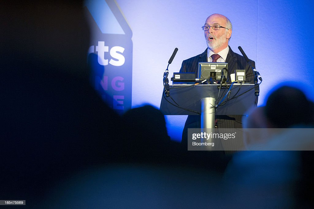 Jim French, non-executive chairman of Flybe Group Plc, Europe's largest independent regional airline, stands at the podium as he speaks during the Airport Operators Association (AOA) annual conference in London, U.K., on Monday, Oct. 21, 2013. The AOA conference is being held ahead of the Airports Commission interim report setting out a shortlist of options for maintaining the UK's status as an international hub for aviation. Photographer: Jason Alden/Bloomberg via Getty Images