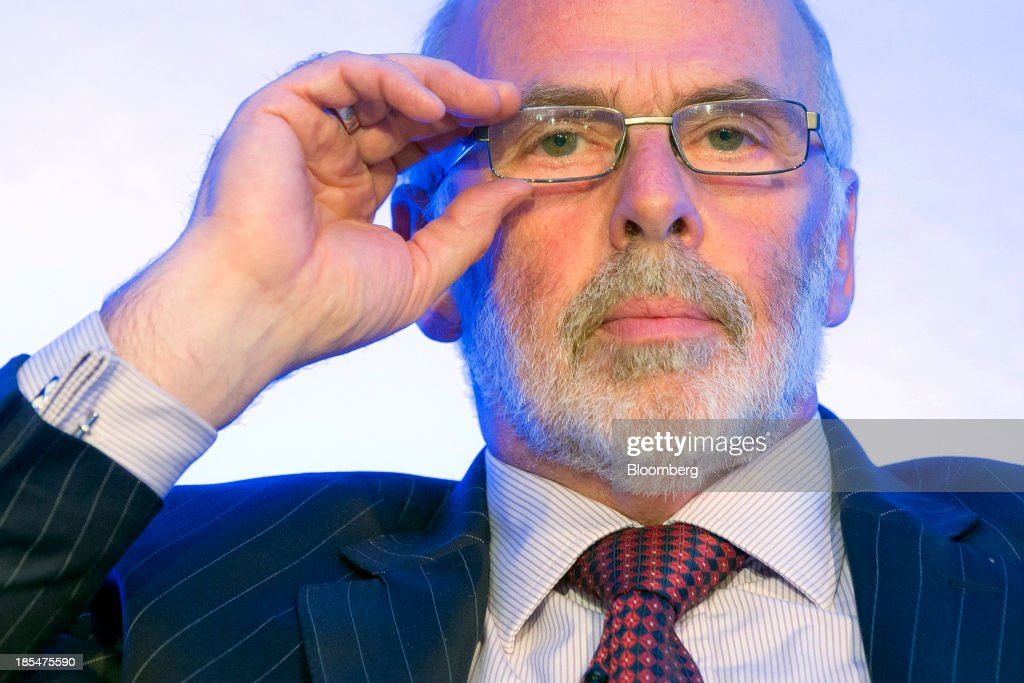 Jim French, non-executive chairman of Flybe Group Plc, Europe's largest independent regional airline, adjusts his spectacles during the Airport Operators Association (AOA) annual conference in London, U.K., on Monday, Oct. 21, 2013. The AOA conference is being held ahead of the Airports Commission interim report setting out a shortlist of options for maintaining the UK's status as an international hub for aviation. Photographer: Jason Alden/Bloomberg via Getty Images