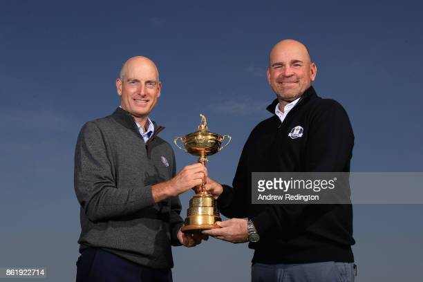 Jim Furyk Captain of The United States and Thomas Bjorn Captain of Europe hold The Ryder Cup during the Ryder Cup 2018 Year to Go event at Le Golf...