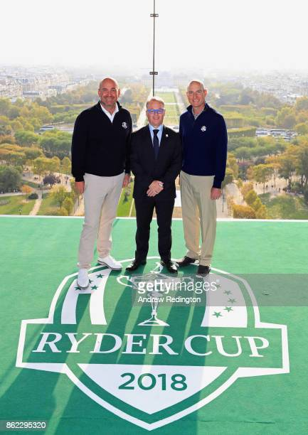 Jim Furyk Captain of The United States and Thomas Bjorn Captain of Europe pose with PGA European Tour CEO Keith Pelley on a platform on the Eiffel...