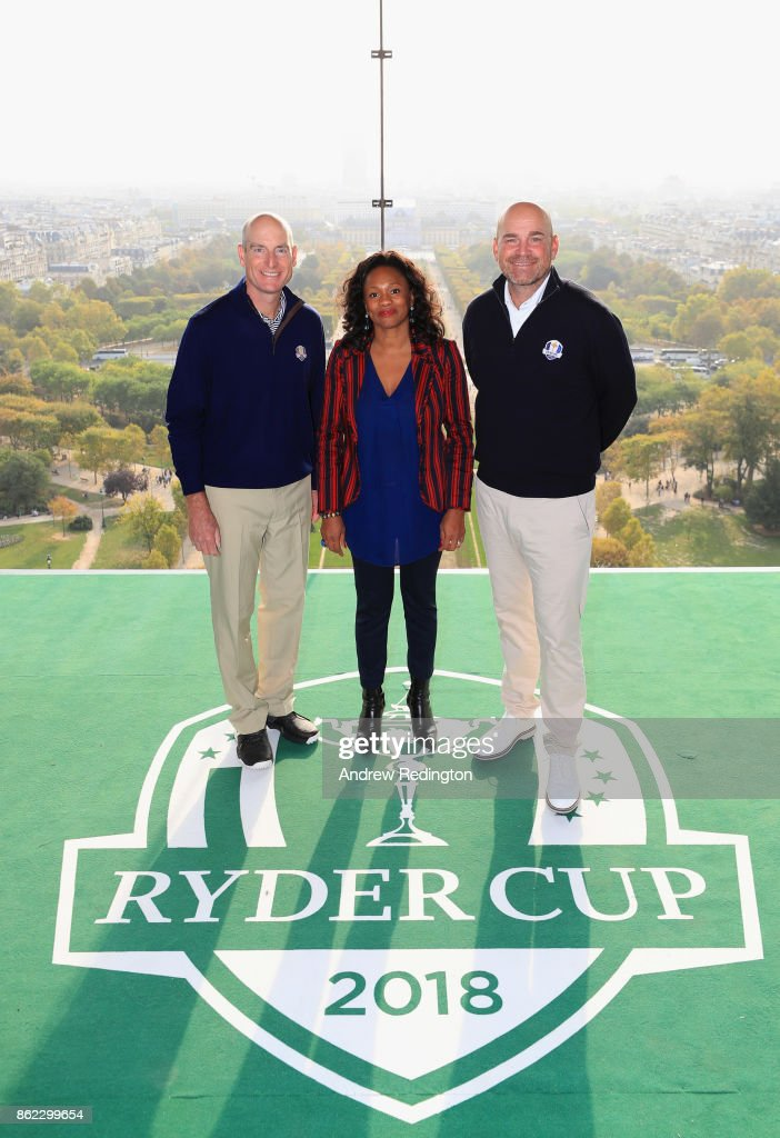 Jim Furyk, Captain of The United States and Thomas Bjorn, Captain of Europe pose with French Minister of Sports, Laura Flessel-Colovic on a platform on the Eiffel Tower during the Ryder Cup 2018 Eiffel Tower Stunt on October 17, 2017 in Paris, France.