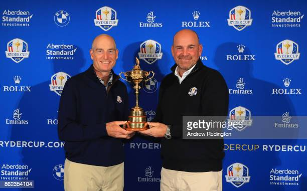 Jim Furyk Captain of The United States and Thomas Bjorn Captain of Europe pose with the Ryder Cup trophy after a Ryder Cup 2018 Year to Go Captains...