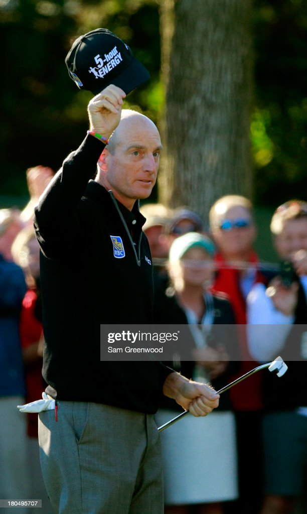 <a gi-track='captionPersonalityLinkClicked' href=/galleries/search?phrase=Jim+Furyk&family=editorial&specificpeople=202579 ng-click='$event.stopPropagation()'>Jim Furyk</a> celebrates after putting on the ninth green to shoot a 59 during the Second Round of the BMW Championship at Conway Farms Golf Club on September 13, 2013 in Lake Forest, Illinois.