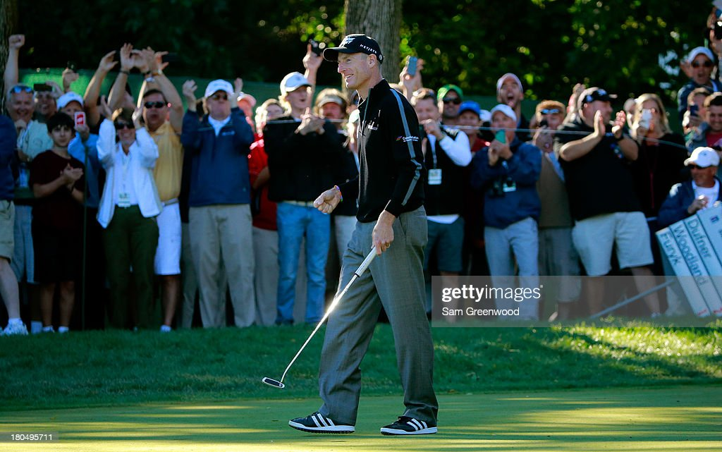 Jim Furyk celebrates after putting on the ninth green to shoot a 59 during the Second Round of the BMW Championship at Conway Farms Golf Club on September 13, 2013 in Lake Forest, Illinois.