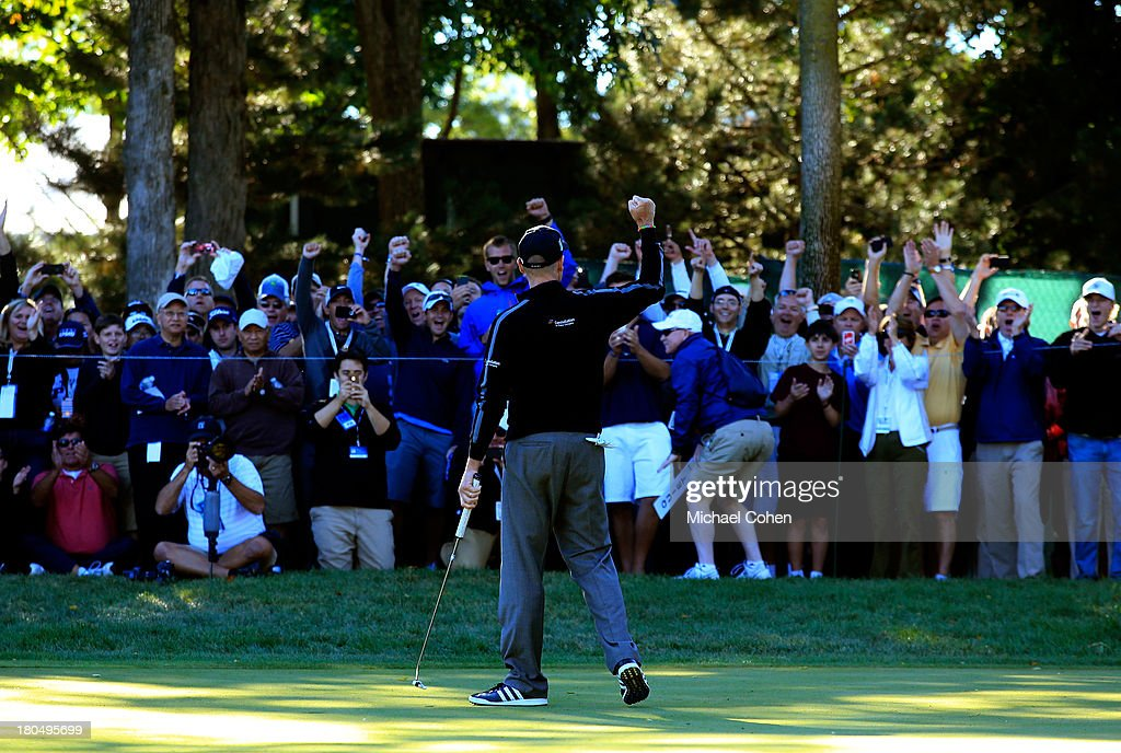 Jim Furyk (R) celebrates after shooting a 59 during the Second Round of the BMW Championship at Conway Farms Golf Club on September 13, 2013 in Lake Forest, Illinois.