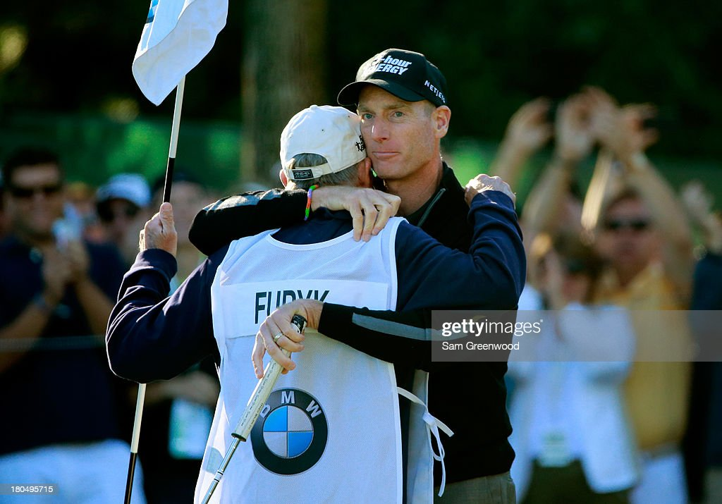 Jim Furyk (R) celebrates with his caddie Mike 'Fluff' Cowan after putting on the ninth green to shoot a 59 during the Second Round of the BMW Championship at Conway Farms Golf Club on September 13, 2013 in Lake Forest, Illinois.