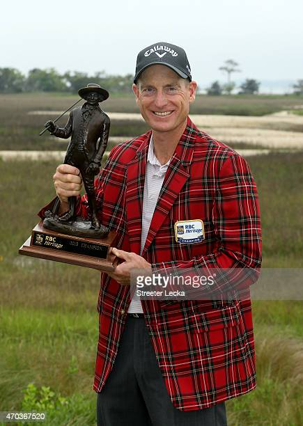 Jim Furyk celebrates with the trophy after winning on the second playoff hole at the RBC Heritage at Harbour Town Golf Links on April 19 2015 in...