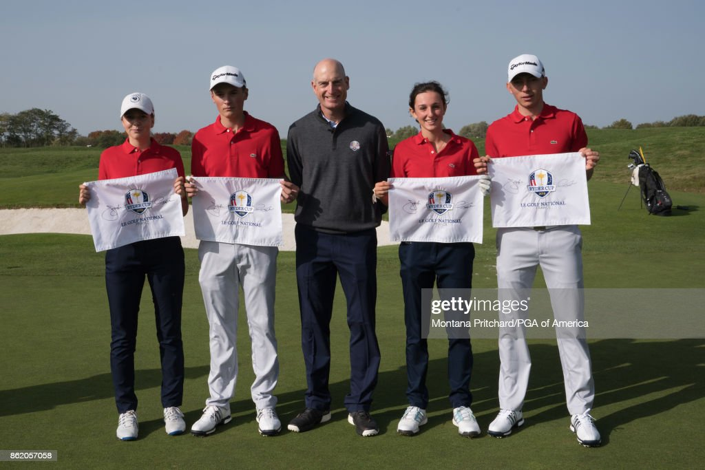 Jim Furyk gathers for a photo with junior golfers during the Junior Matches at the Ryder Cup Year To Go Celebration at Le Golf National on October 16, 2017 in Guyancourt, France.
