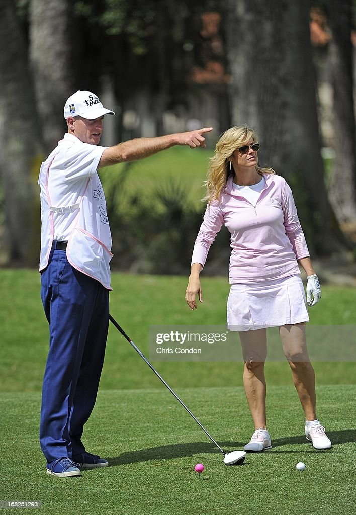 <a gi-track='captionPersonalityLinkClicked' href=/galleries/search?phrase=Jim+Furyk&family=editorial&specificpeople=202579 ng-click='$event.stopPropagation()'>Jim Furyk</a> helps his wife Tabitha line up a shot on the second hole during PGA TOUR Wives Classic golf tournament held on Dye's Valley course before THE PLAYERS Championship on THE PLAYERS Stadium Course at TPC Sawgrass on May 7, 2013 in Ponte Vedra Beach, Florida.