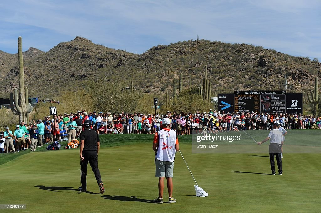 Jim Furyk hits a putt on the tenth hole during the quarterfinal match of the World Golf Championships-Accenture Match Play Championship at The Golf Club at Dove Mountain on February 22, 2014 in Marana, Arizona.