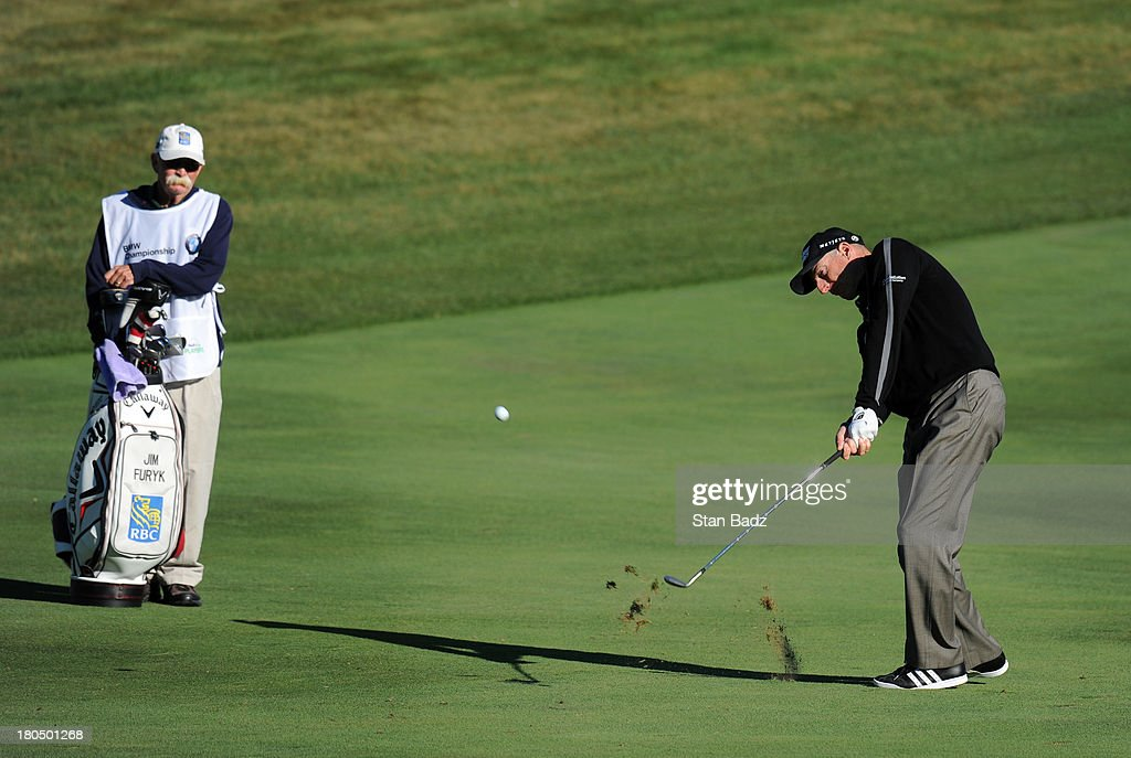 Jim Furyk hits a second shot to the ninth green during the second round of the BMW Championship at Conway Farms Golf Club on September 13, 2013 in Lake Forest, Illinois.