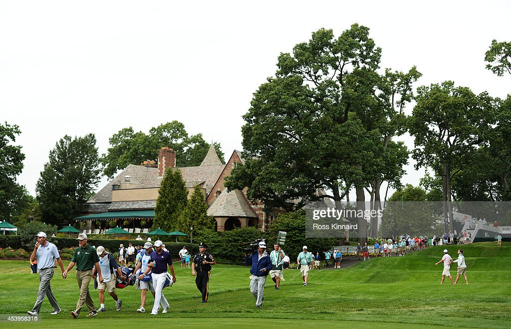 Jim Furyk, Matt Kuchar and Sergio Garcia of Spain walk past the club house on the first hole during the second round of The Barclays at The Ridgewood Country Club on August 22, 2014 in Paramus, New Jersey.