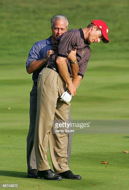 Jim Furyk of Team USA suffering from a bad back is attended to by Tom LaFontaine during Thursday's Foursome matches of the 2005 Presidents Cup on...