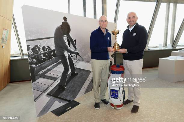 Jim Furyk of the United States Captain of Team America and Thomas Bjorn of Denmark Captain of Team Europe pose for a portrait with the Ryder Cup in...